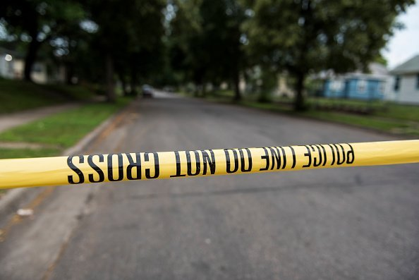 A piece of police tape at a crime scene | Photo: Getty Images