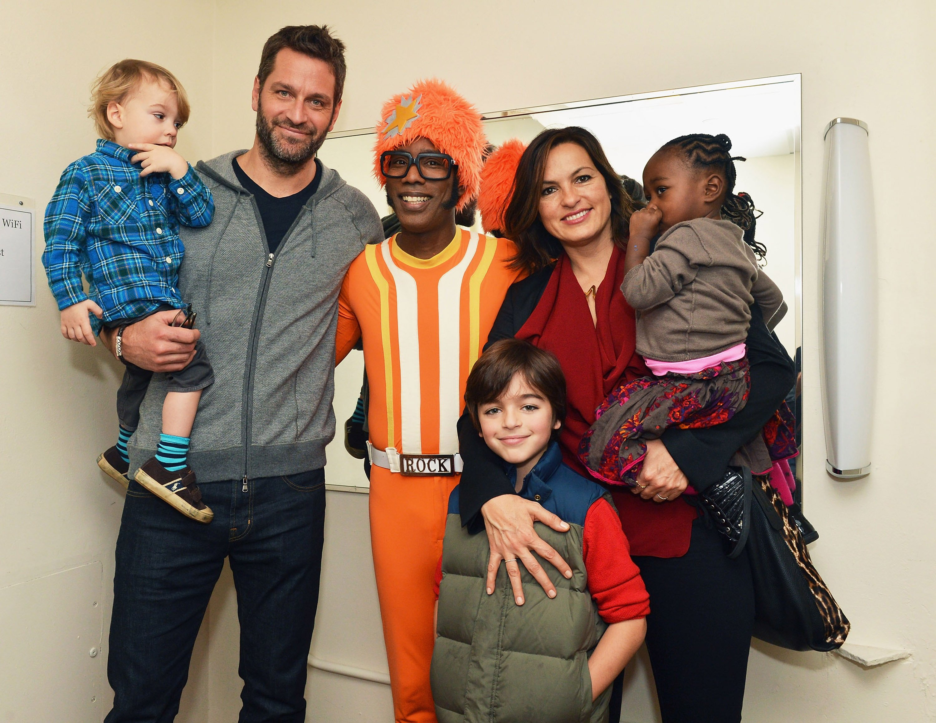 "(From left to right) Andrew Hermann, Peter Herman, DJ Lance Rock, August Hermann, Mariska Hargitay, and Amaya Herman attend ""Yo Gabba Gabba Live"" at a New York City theatre on December 21, 2013 