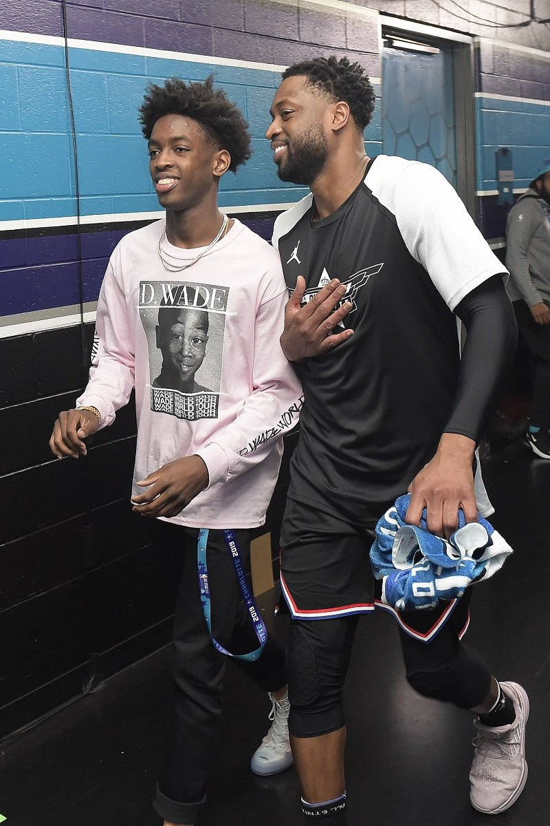 Zaire Wade and Dwyane Wade on February 17, 2019 at Spectrum Center in Charlotte, North Carolina. | Source: Getty Images