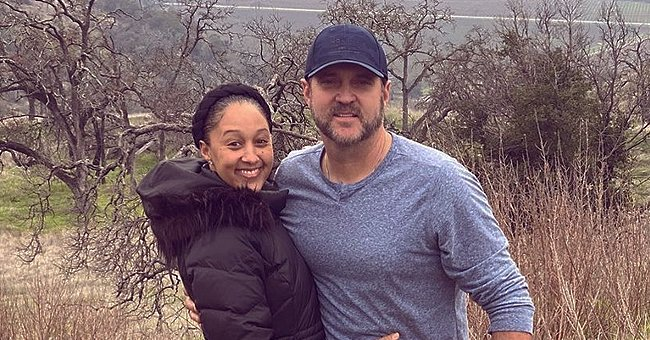 Tamera Mowry's Daughter Ariah Sits on Her Dad's Shoulders in a Pic Showing Their Similar Smiles