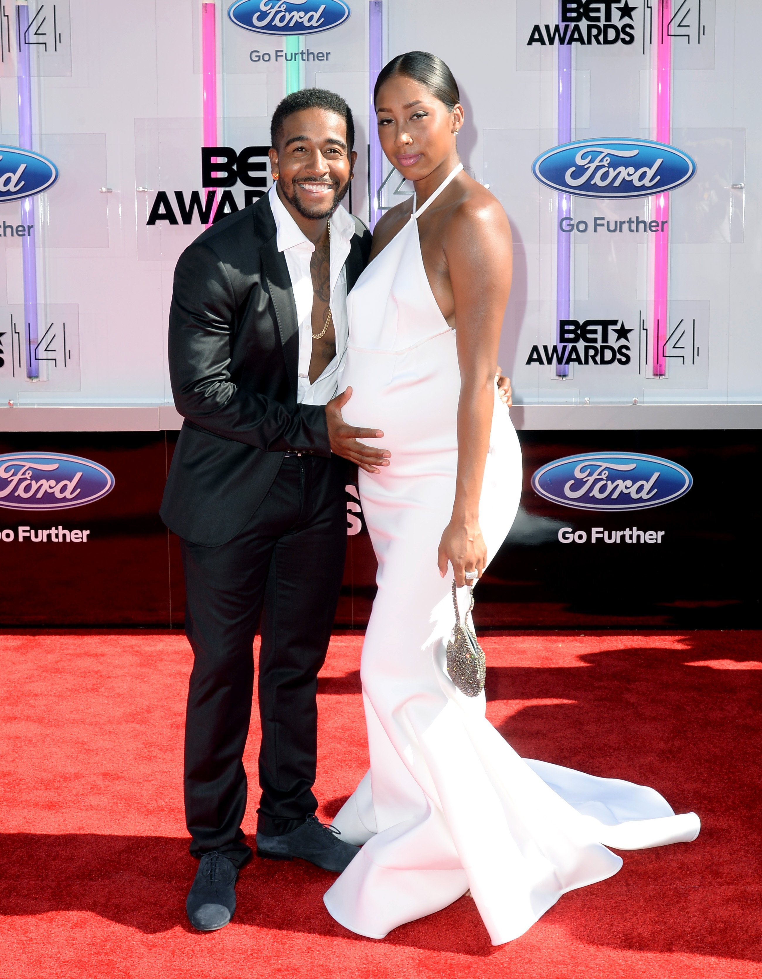 (Happier times) A pregnant Apryl Jones & Omarion at the BET awards in Los Angeles, California on June 29, 2014. |Photo: Getty Images