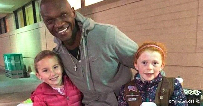 Girl Scouts posing with their Good Samaritan | Source: Twitter, CBS