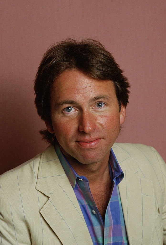 "John Ritter, best known for his role as ""Jack Tripper"" on the hit TV series ""Three's Company"" poses during a 1987 studio portrait session in Beverly Hills, California 