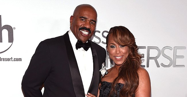Fans Praise Steve Harvey's Wife's Style as She Poses in a Long Louis Vuitton Coat with Fur Boots