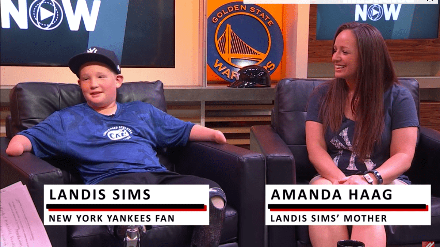 Landis Sims and his mother during an Interview with Sports Illustrated from June 15, 2017 | Source: Youtube/ Sports Illustrated