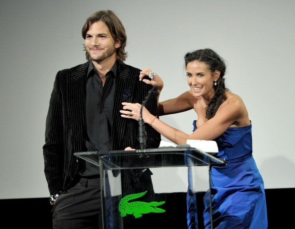 Ashton Kutcher (L) and Demi Moore speak onstage at the 13th Annual Costume Designers Guild Awards with presenting sponsor Lacoste held at The Beverly Hilton hotel on February 22, 2011, in Beverly Hills, California. | Source: Getty Images.