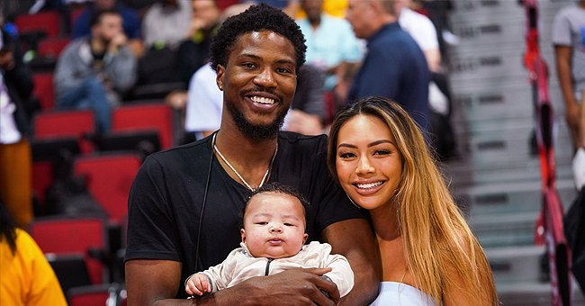 Malik Beasley and wife Montana Yao pose with their son Makai Beasley courtside at the NBA Summer League on July 07, 2019 | Photo: Getty Images
