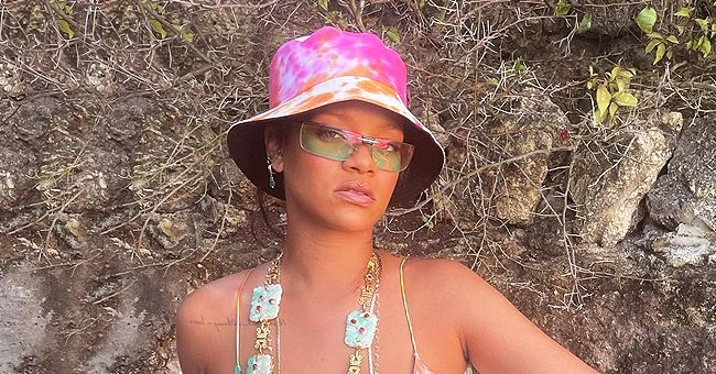 Rihanna Flaunts Her Curves in a $295 Retro Style Dress with a Hat & Vintage Chanel Sunglasses