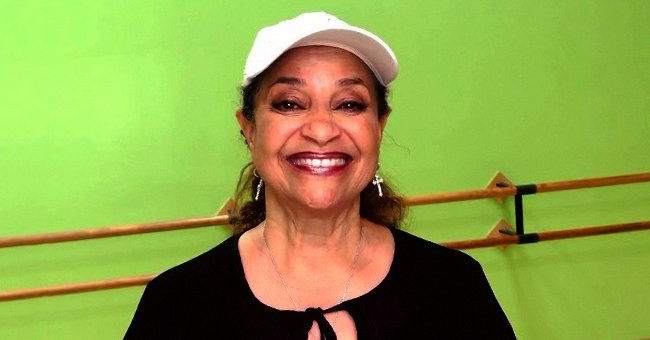 'Fame' Star Debbie Allen Flaunts Her Curly Natural Hair Posing in a Gray Jacket & Peach Shirt