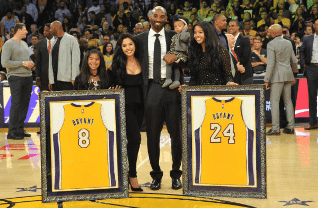 Kobe Bryant, Vanessa Bryant and their daughters Gianna Bryant, Natalia Bryant and Bianka Bella Bryant pose with his retired jerseys during a ceremony at the Staples Center on December 18, 2017, in Los Angeles, California | Source: Allen Berezovsky/Getty Images