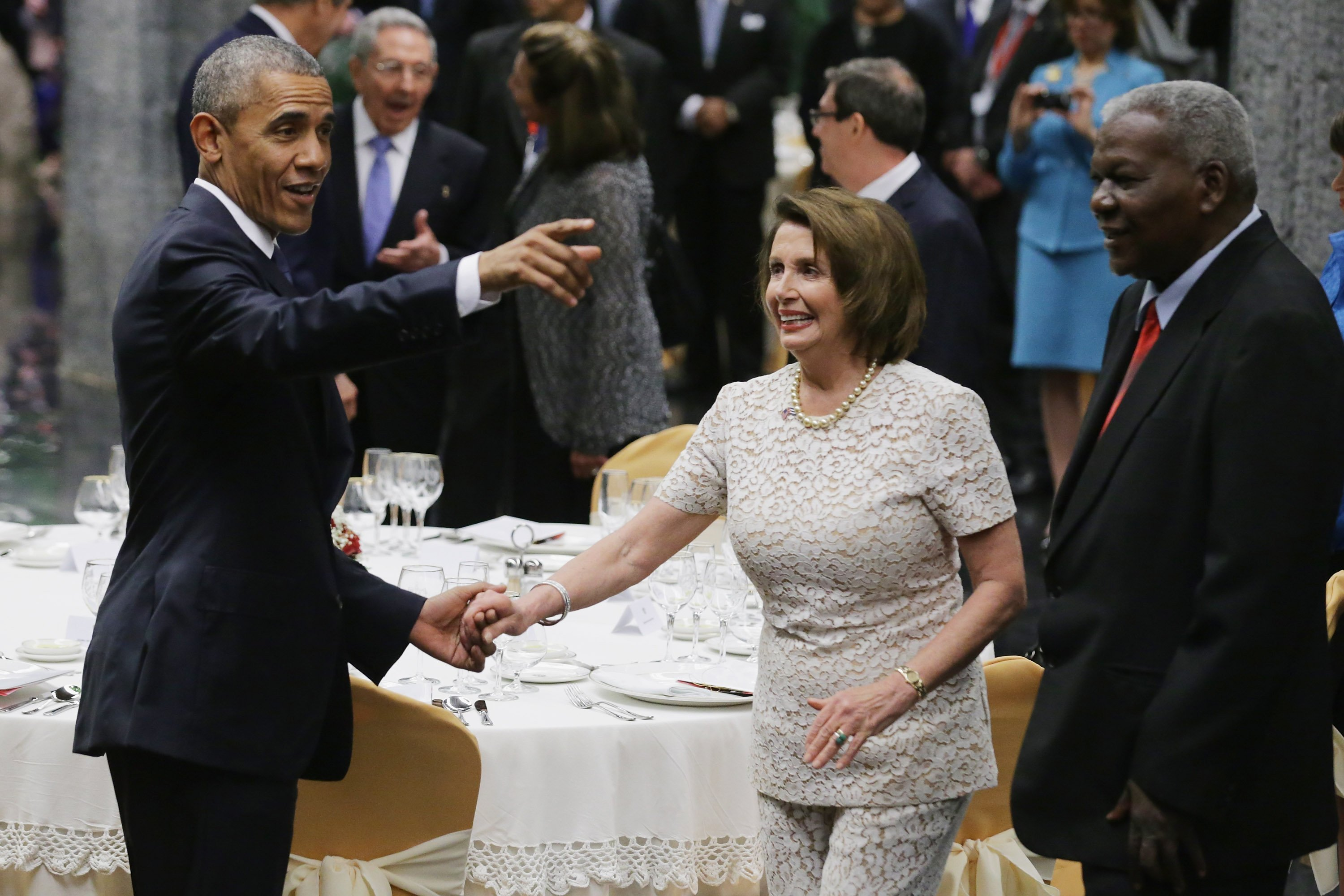 Barack Obama and Nancy Pelosi at a tate dinner at the Palace of the Revolution in Havana, Cuba | Photo: Getty Images