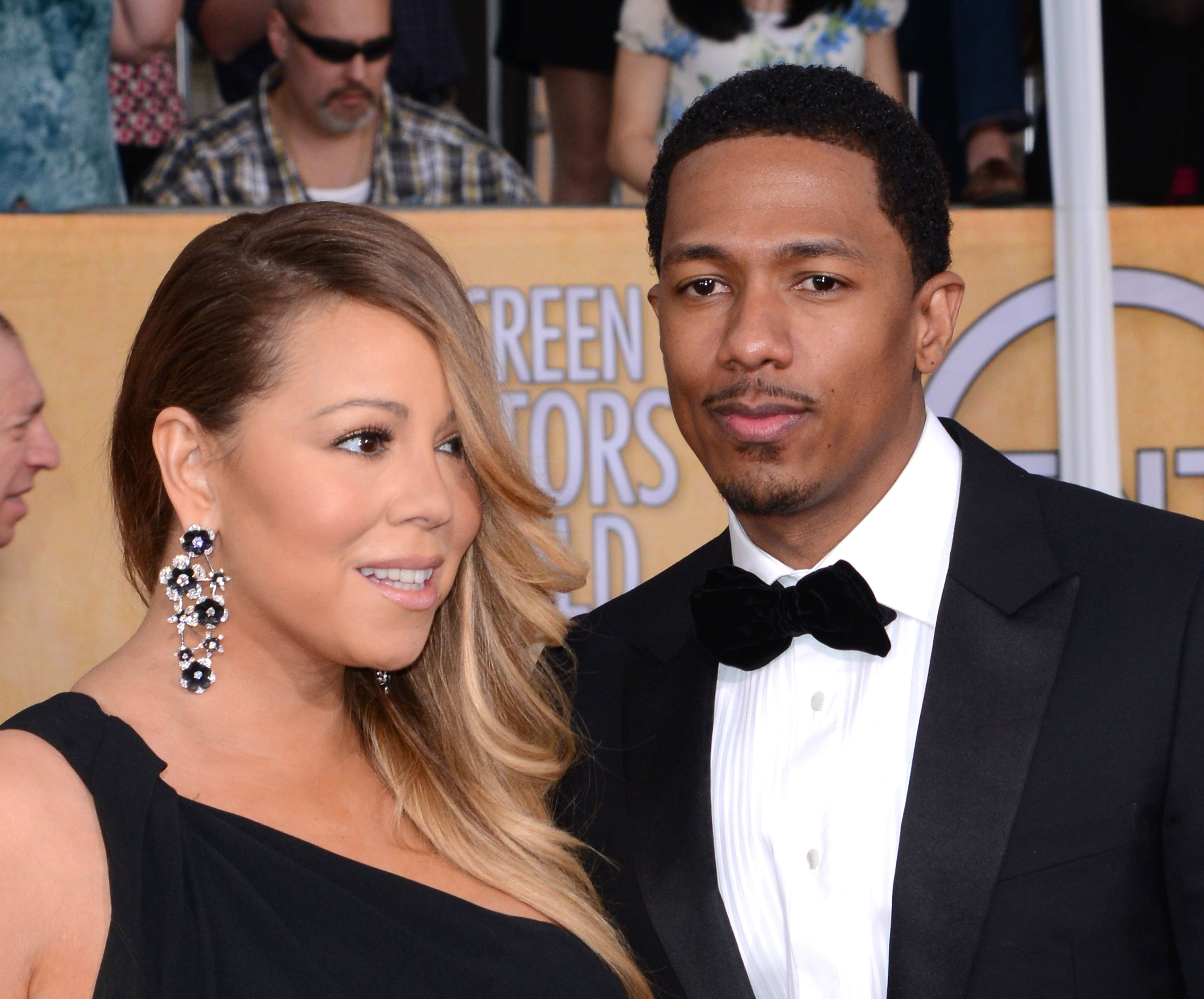 Mariah Carey and Husband Nick Cannon arrive at the 20th Annual Screen Actors Guild Awards at The Shrine Auditorium on January 18, 2014, in Los Angeles, California. | Source: Getty Images.