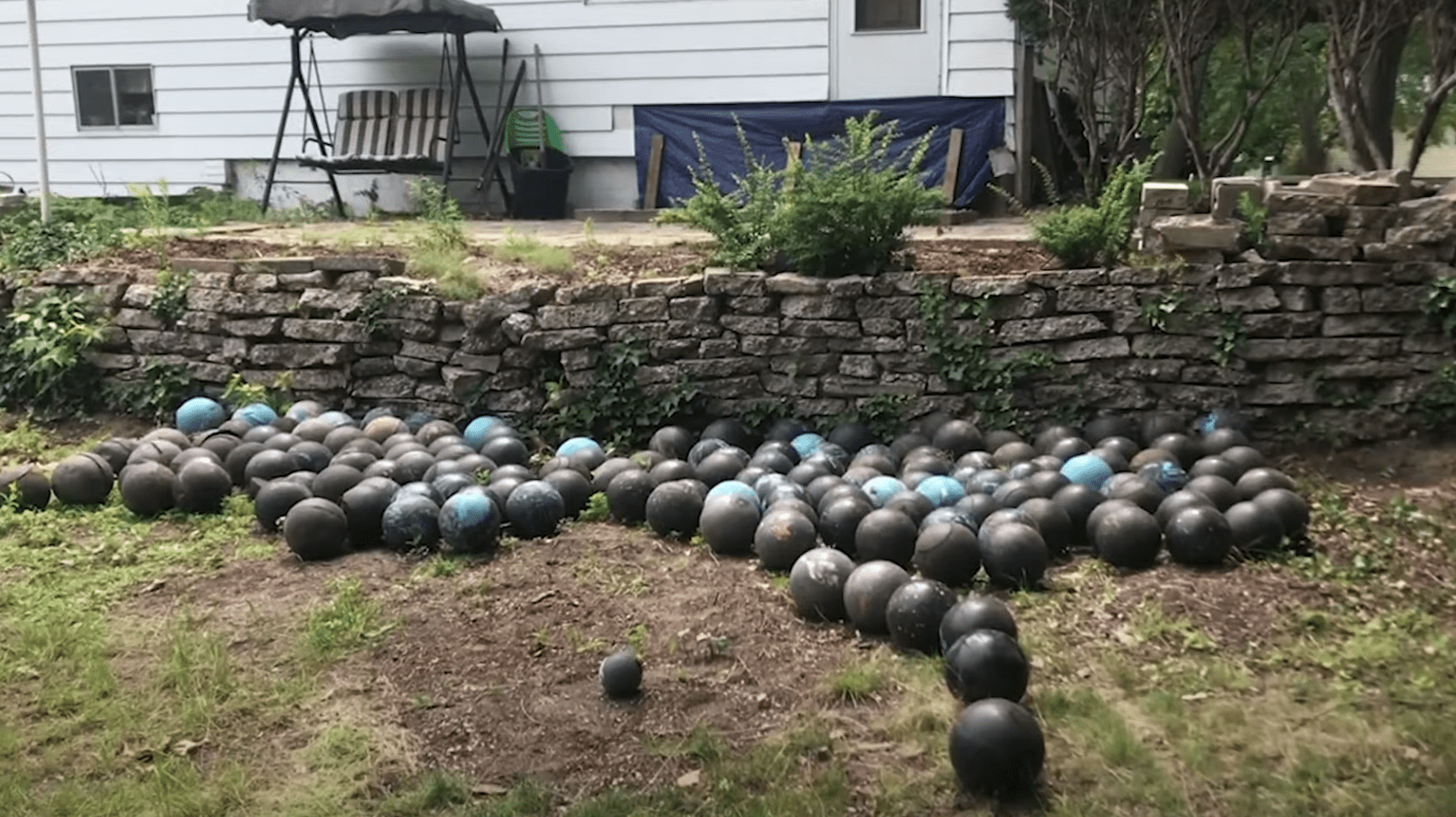 Bowling bowls found under a man's house | Photo: Youtube/mlive