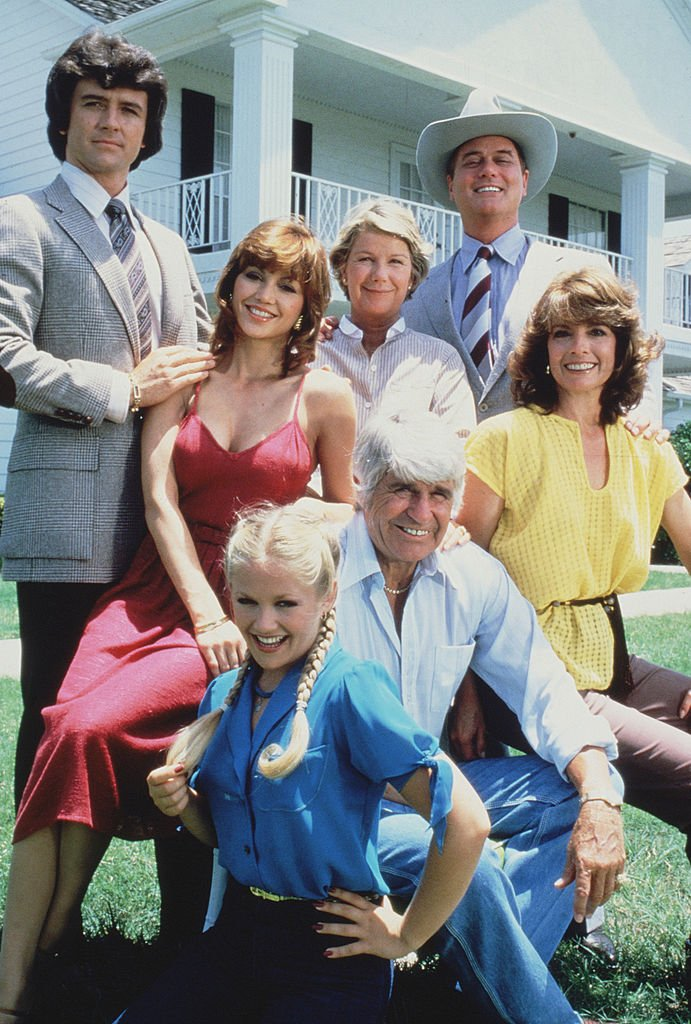 """A photo that shows the members of the Ewing family from the American television series """"Dallas"""" shows posing in front of their television home, the Southfork Ranch, Dallas, on January 1, 1979 