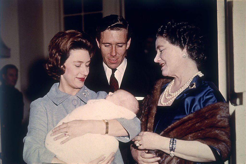 The Queen Mother is introduced to baby David Linley in 1961 by his proud parents Princess Margaret (L) and Lord Snowdon | Photo: Getty Images