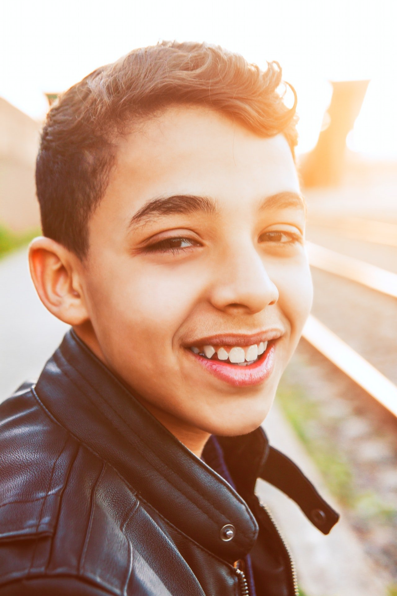 Photo of a young boy smiling   Photo: Pexels