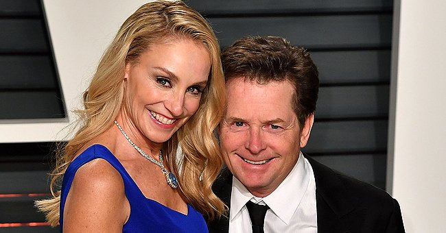 ET Online: Michael J Fox Says Wife Tracy Bears with Him Amid His Battle with Parkinson's
