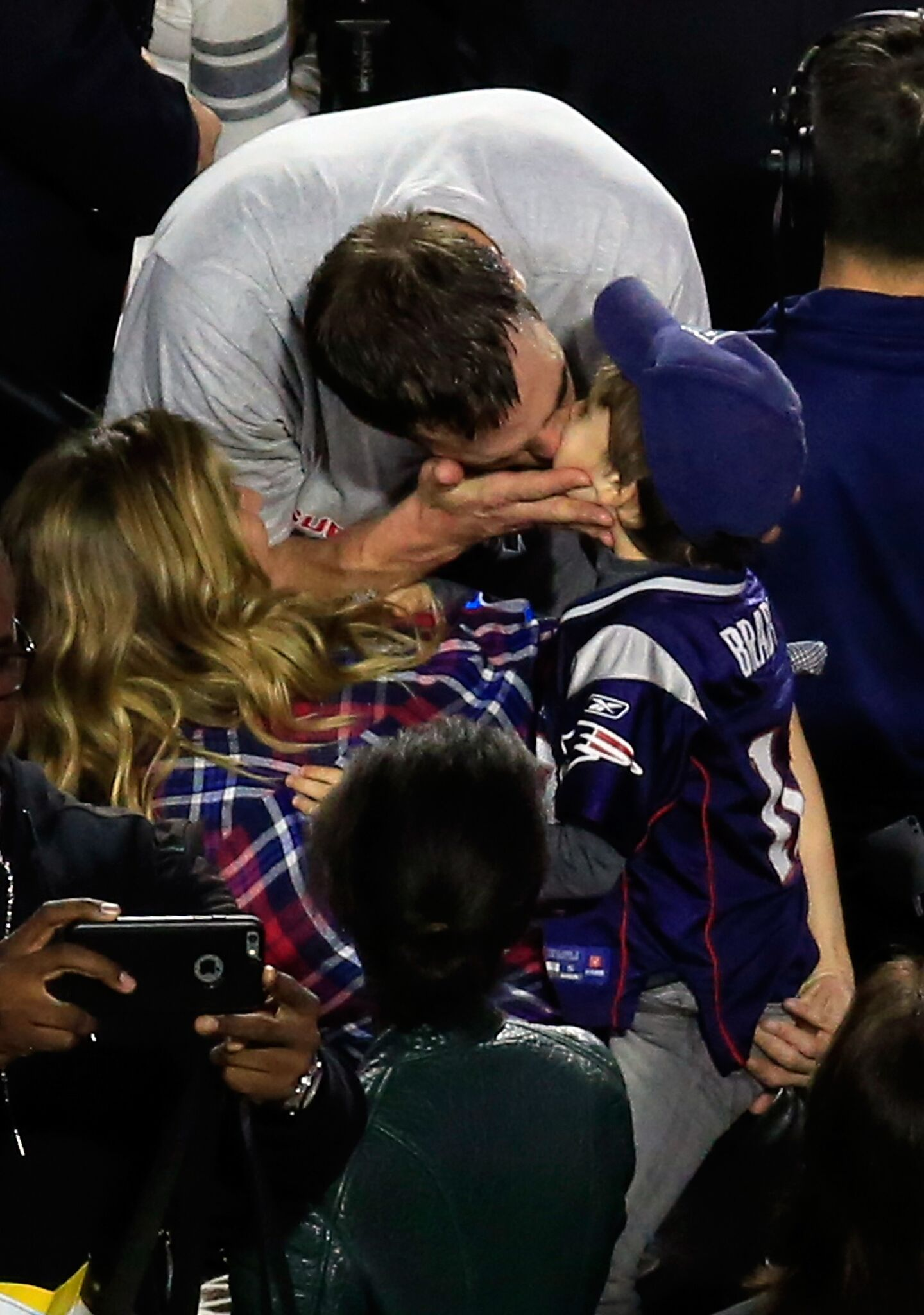 Tom Brady #12 of the New England Patriots celebrates defeating the Seattle Seahawks with his wife Gisele Bundchen and son Benjamin during Super Bowl XLIX at University of Phoenix Stadium | Getty Images