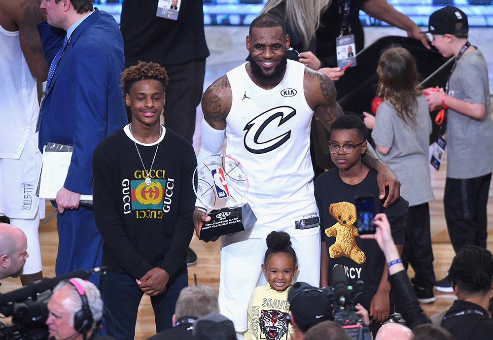 LeBron James Jr., LeBron James #23, Zhuri James and Bryce Maximus James pose for a photo with the All-Star Game MVP trophy during the NBA All-Star Game 2018 at Staples Center on February 18, 2018 in Los Angeles, California. I Image: Getty Images.