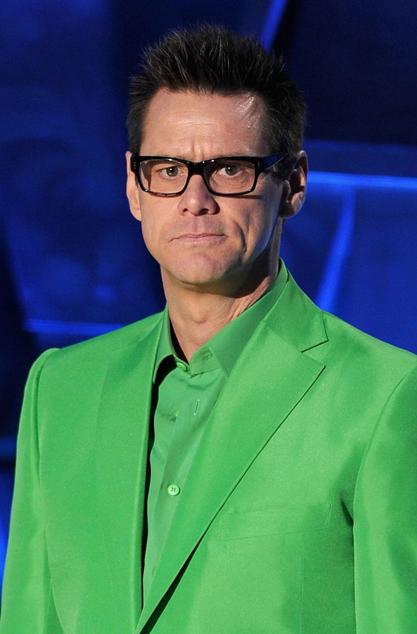 Jim Carrey speaks onstage during the 2011 MTV Movie Awards at Universal Studios' Gibson Amphitheatre | Getty Images