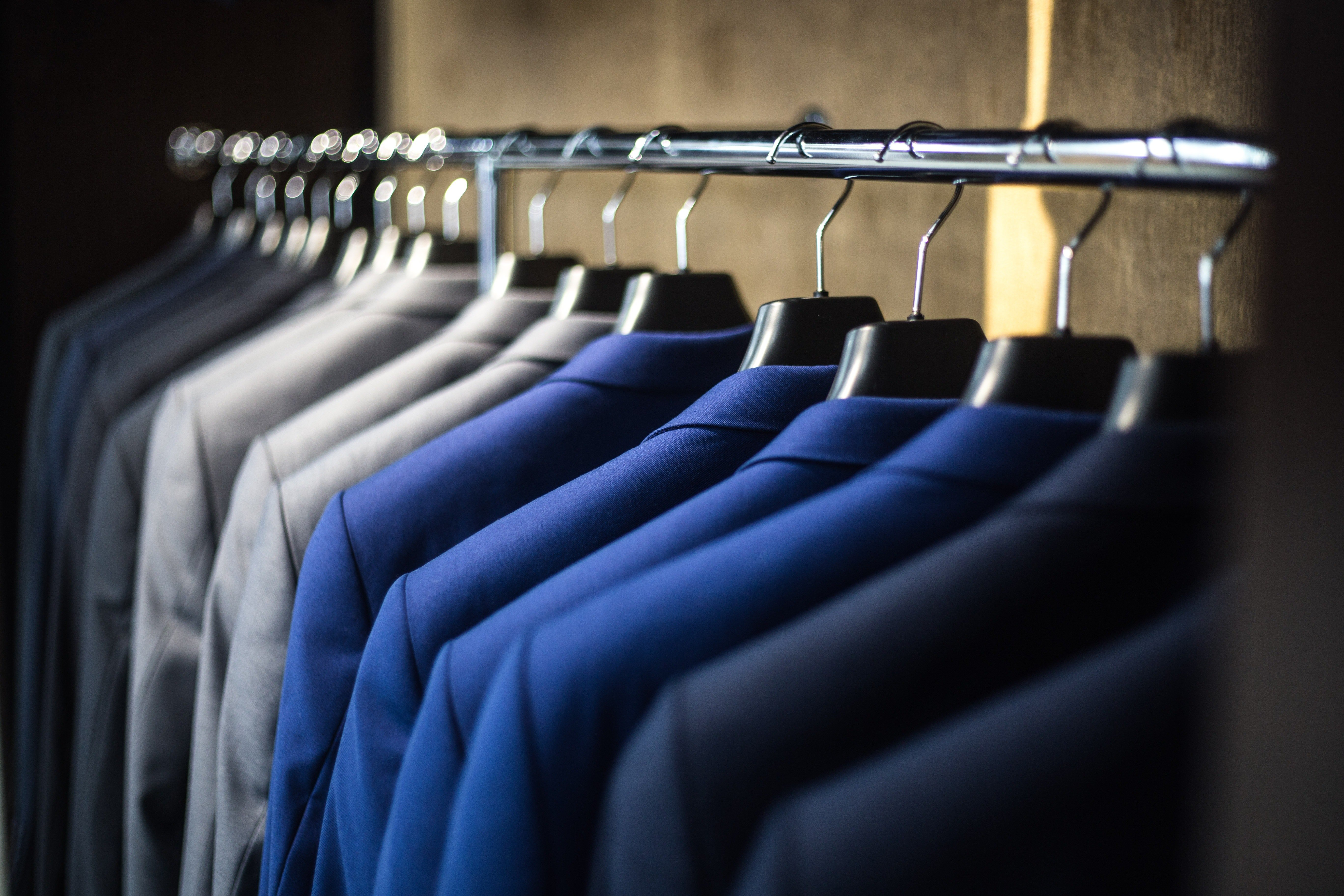 Pictured - A close-up of a row of suits   Source: Pexels