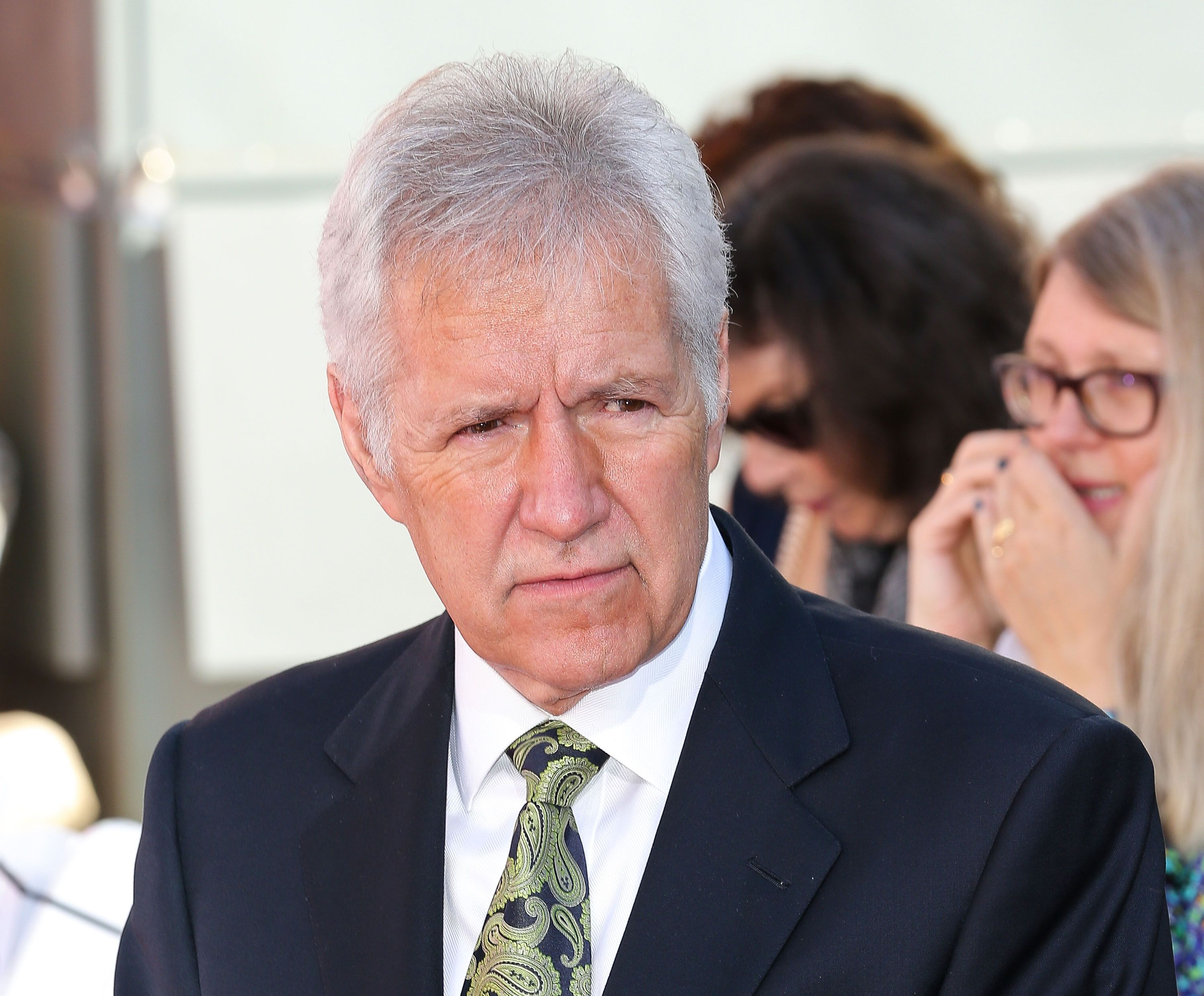 Alex Trebek at the TCM hand and footprint ceremony of  Christopher Plummer on March 27, 2015 | Photo: Getty Images