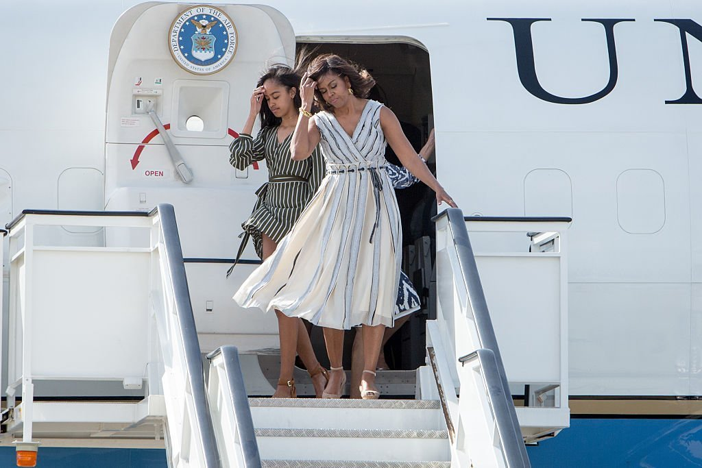 Lady Michelle Obama and her daughter Malia Obama arrive at Torrejon Air Force Base | Photo: Getty Images