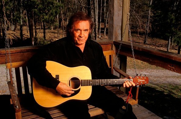 Late actor Johnny Cash, holding a Takamine acoustic guitar | Photo: Getty Images