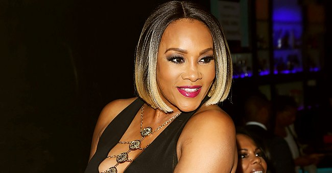 Vivica A Fox Shows Her Hourglass Figure in TBT Pics Wearing a Tiger-Print Roberto Cavalli Dress