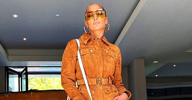 Jennifer Lopez Looks Stunning Posing in a Fox-Color Jumpsuit and Matching High Heel Boots