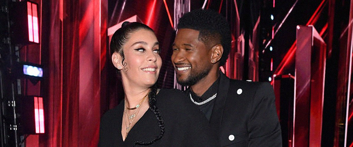 See Usher's Girlfriend Showing Her Blossoming Baby Bump in Denim Overalls under Rain of Dollars near Him
