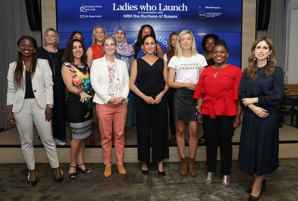 Meghan poses with 12 inspiring female entrepreneurs as she visits Woodstock Exchange. | Source: Getty Images