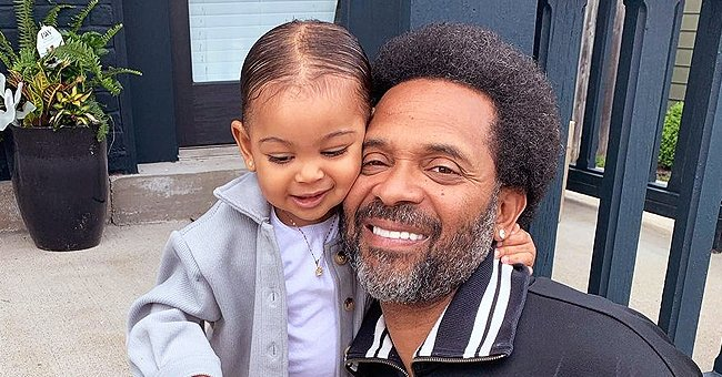Mike Epps' Daughter Poses like a Boss Baby in a Gray Coat, Skirt, & Shirt Snuggling up to Dad