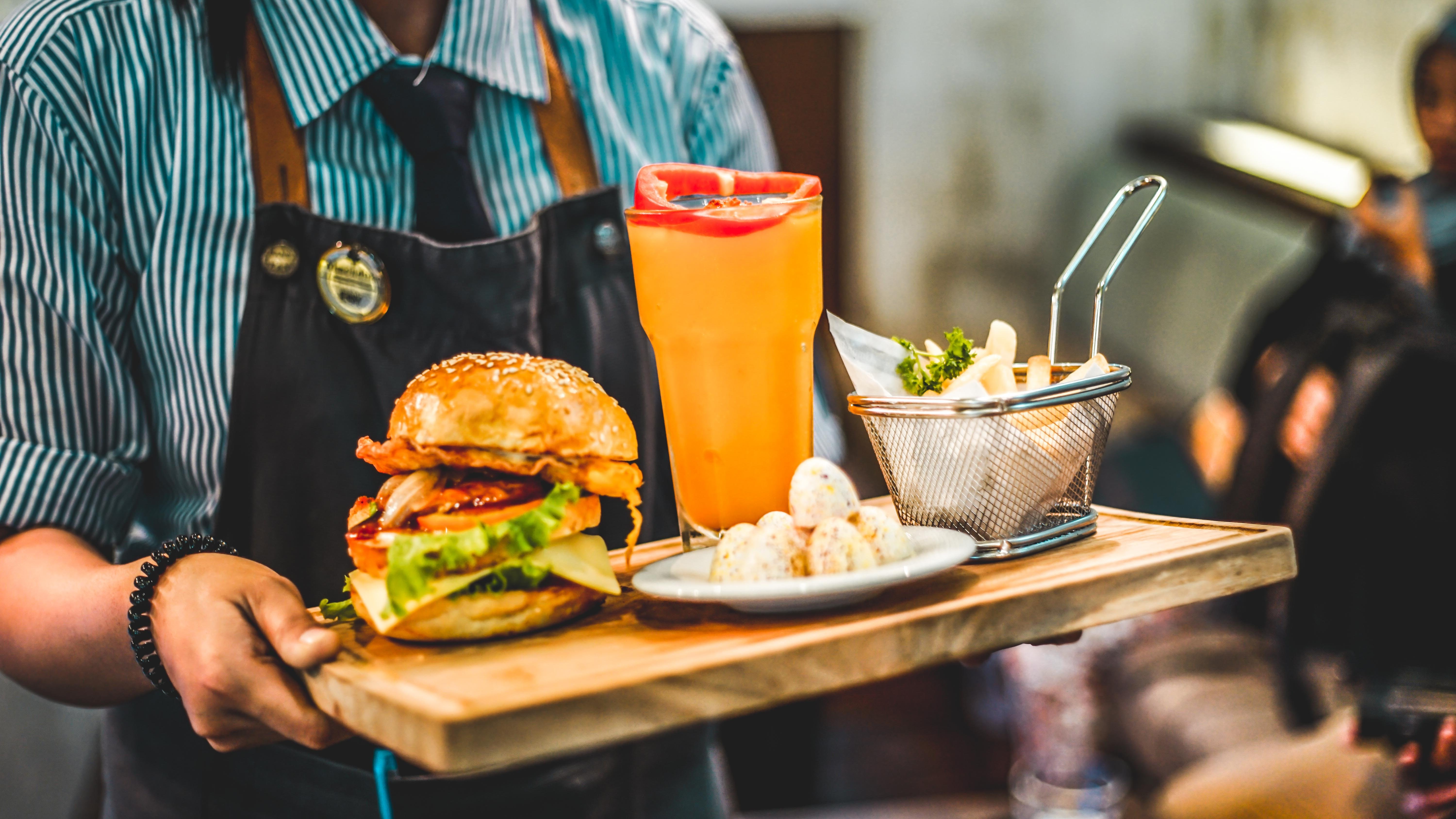 Burger, fries, and soft drink. | Source: Unsplash