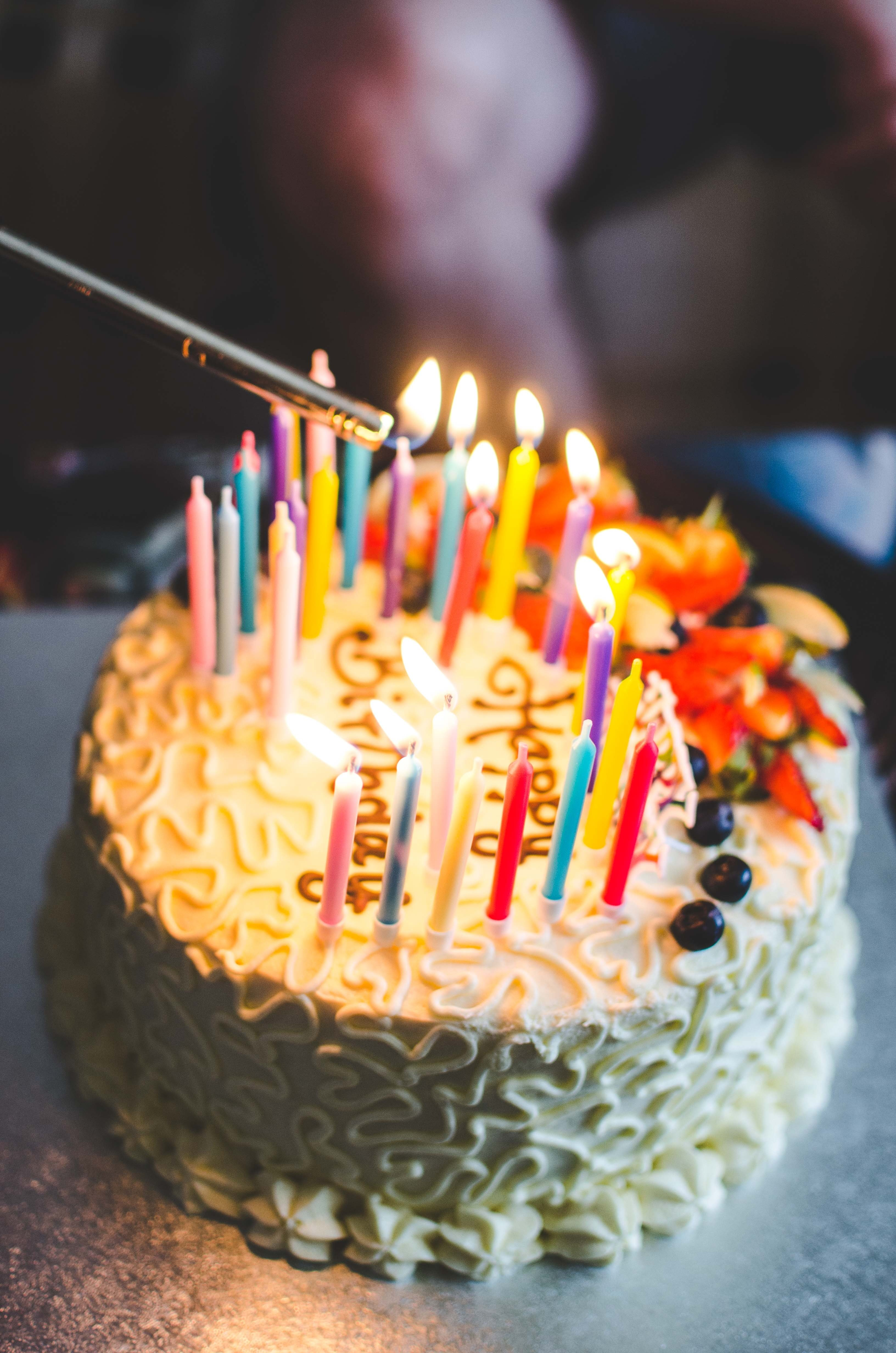 A picture of someone lighting the candles on a birthday cake. | Source: Unsplash