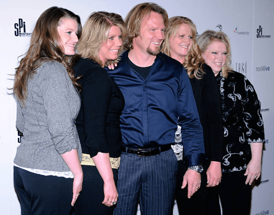 """Sister Wives"" stars Robyn Brown, Meri Brown, Kody Brown, Christine Brown and Janelle Brown pose on the read carpet at the grand opening for ""Mike Tyson: Undisputed Truth - Live on Stage,"" on April 14, 2012, in Las Vegas, Nevada 