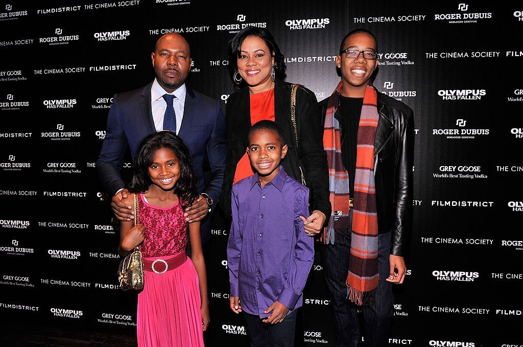"Antoine Fuqua & Lela Rochon pose with their children at a screening of ""Olympus Has Fallen"" in New York City on Mar. 11, 2013. 