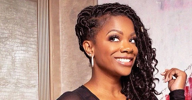 Kandi Burruss Flashes a Wide Smile as She Flaunts Her Hourglass Figure in a Sheer Leather Dress