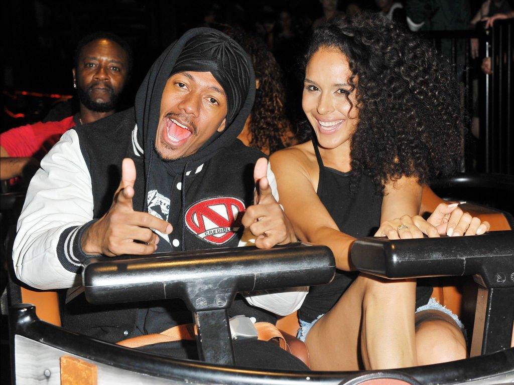Nick Cannon and Brittany Bell ride the 'Ghostrider' roller coaster at Knott's Berry Farm on September 1, 2017 in Buena Park, California.|Source: Getty Images