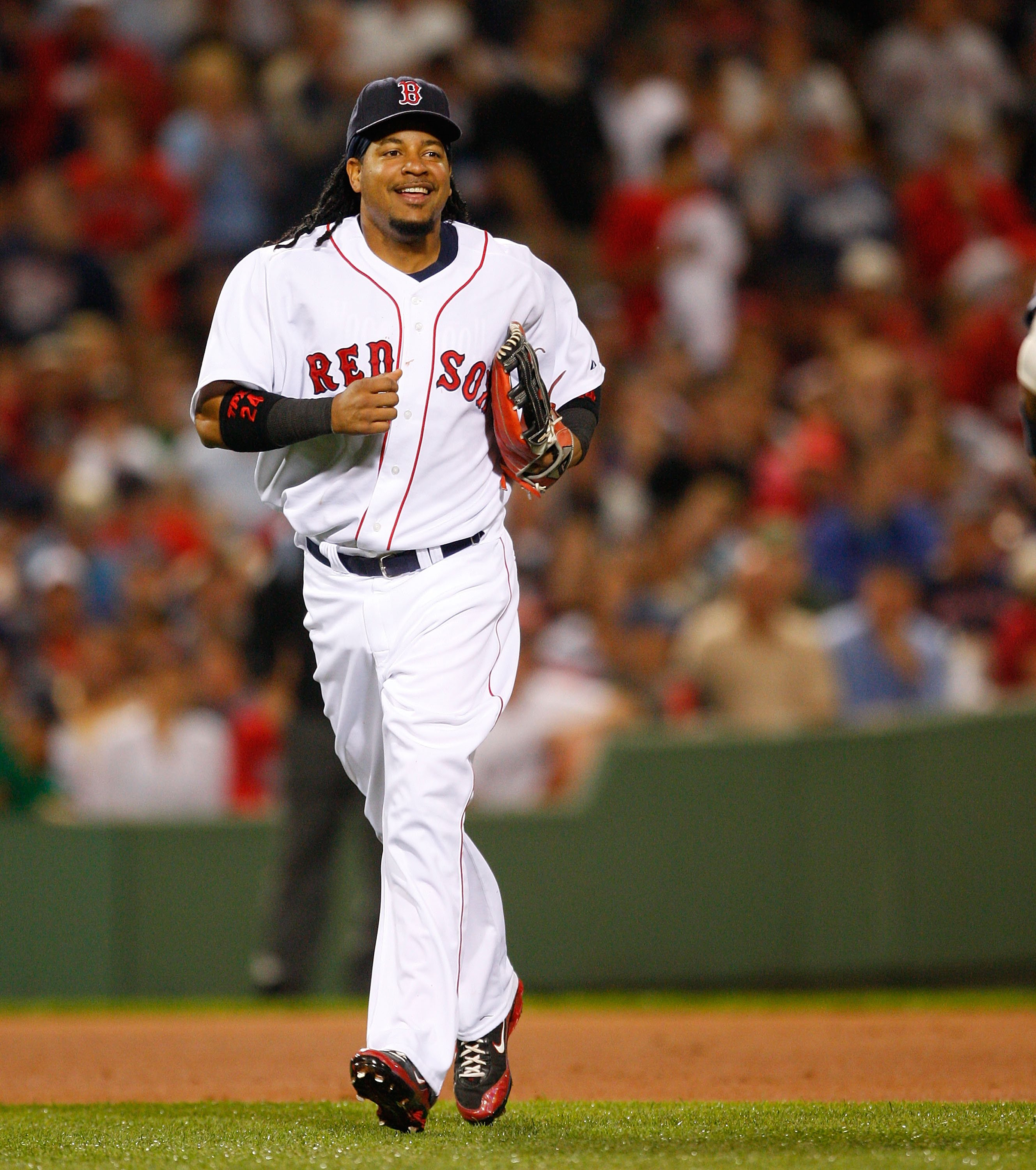 Manny Ramirez #24 of the Boston Red Sox smiles after making a catch off of Alex Rodriguez of the New York Yankees at Fenway Park on July 27, 2008 in Boston, Massachusetts. | Photo: GettyImages