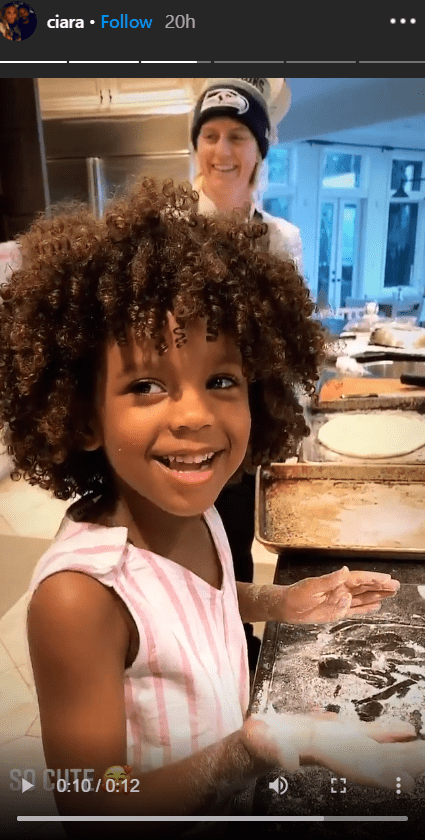 Ciara's daughter, Sienna, seen smiling at the camera while mixing dough in a recent Instagram story post. | Photo: Instagram/Ciara