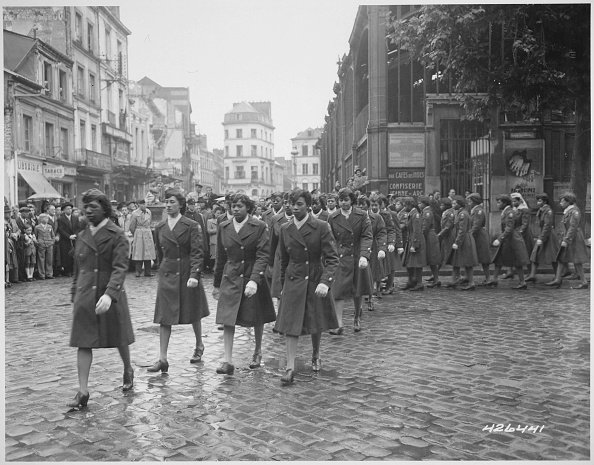 Members of the 6888th Central Postal Directory Battalion take part in a parade ceremony in honor of Joan d'Arc at the marketplace where she was burned at the stake in 1945. | Photo: GettyImages