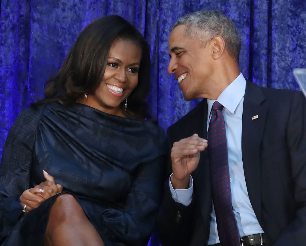 Former U.S. President Barack Obama and first lady Michelle Obama participate in the unveiling of their official portraits during a ceremony at the Smithsonian's National Portrait Gallery in Washington, DC | Photo: Getty Images