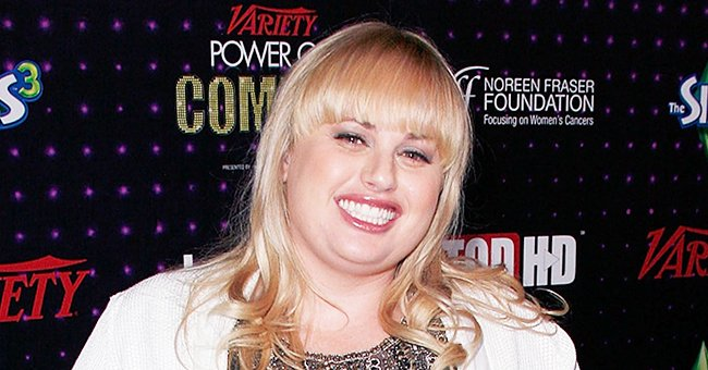 Rebel Wilson Thrilled Fans as She Playfully Posed in Pink Swimsuit in a Swimming Pool