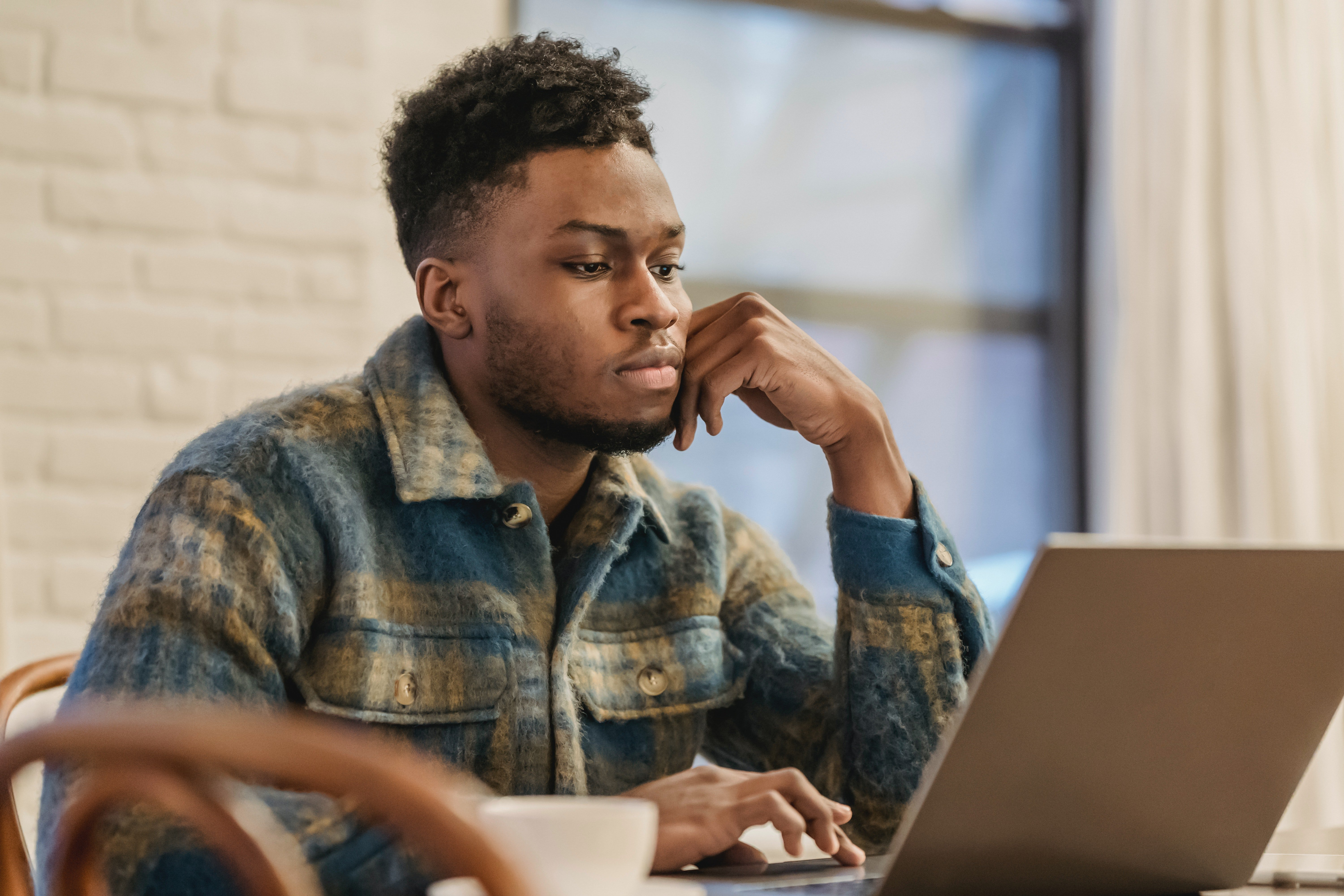Pictured - A young man working on a laptop | Source: Pexels