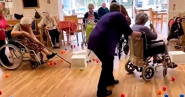 Residents of British Nursing Home Play 'Hungry Hippos' during Quarantine