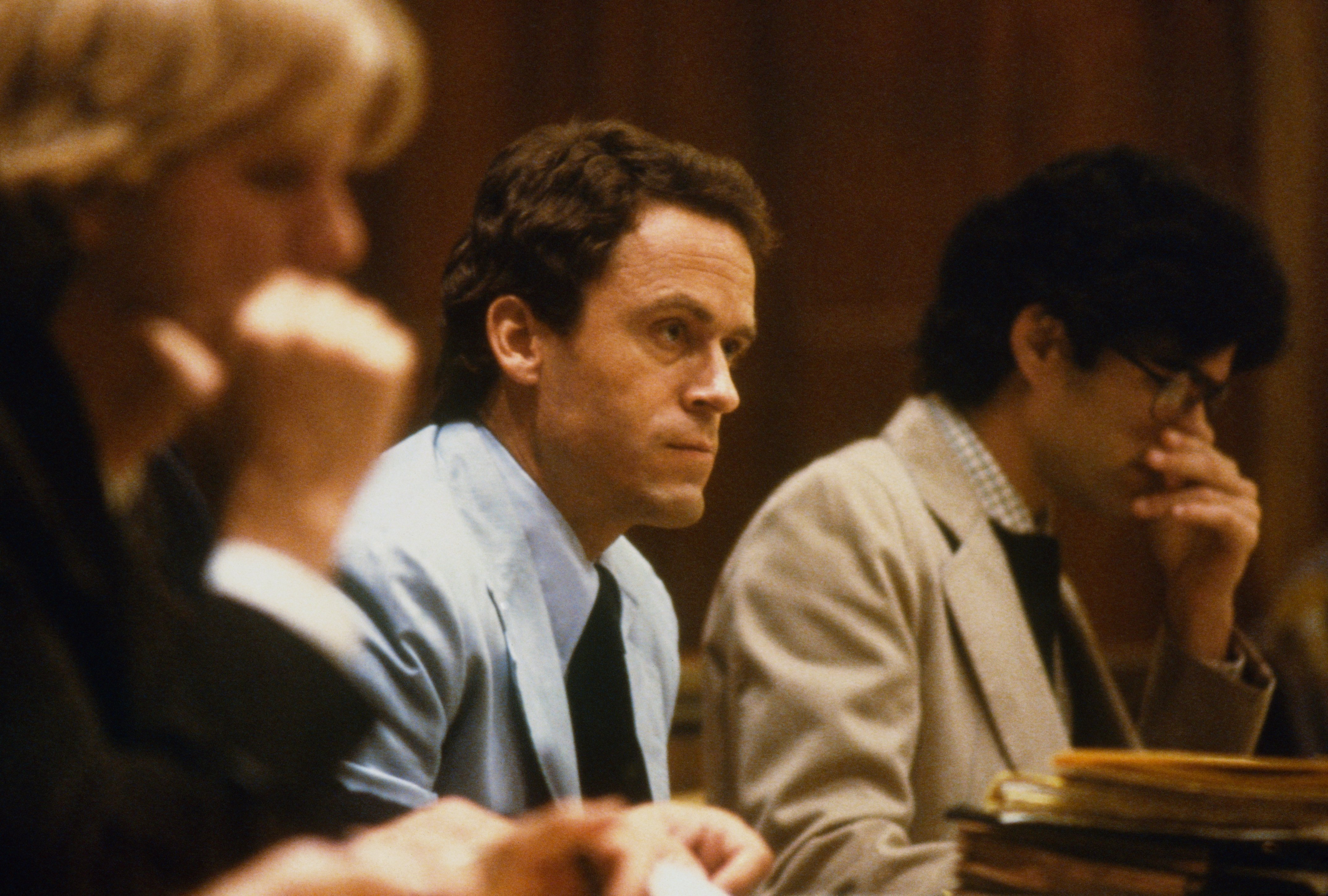 Theodore Bundy, seated in court, charged with the killings of two FSU coeds.| Source: Getty Images