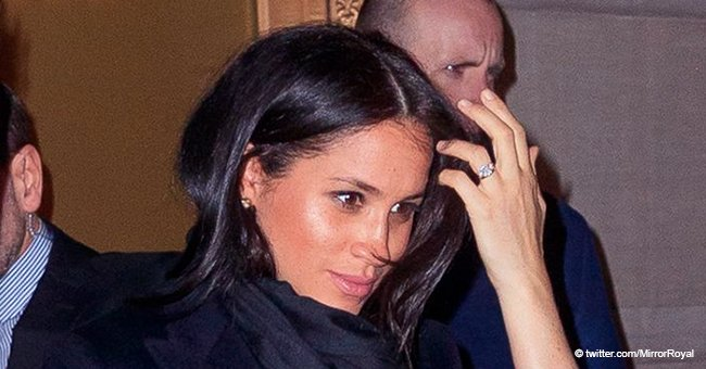 Meghan Markle spotted in a black outfit with shiny haircalf boots enjoying a busy evening in NYC