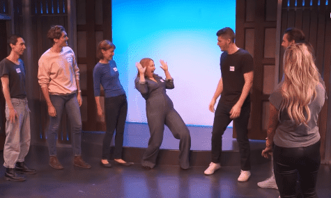 A group of aspiring comedians warm up during an improv class with Kim Kardashian and Scott Disick. | Source: YouTube/Keeping Up With The Kardashians.