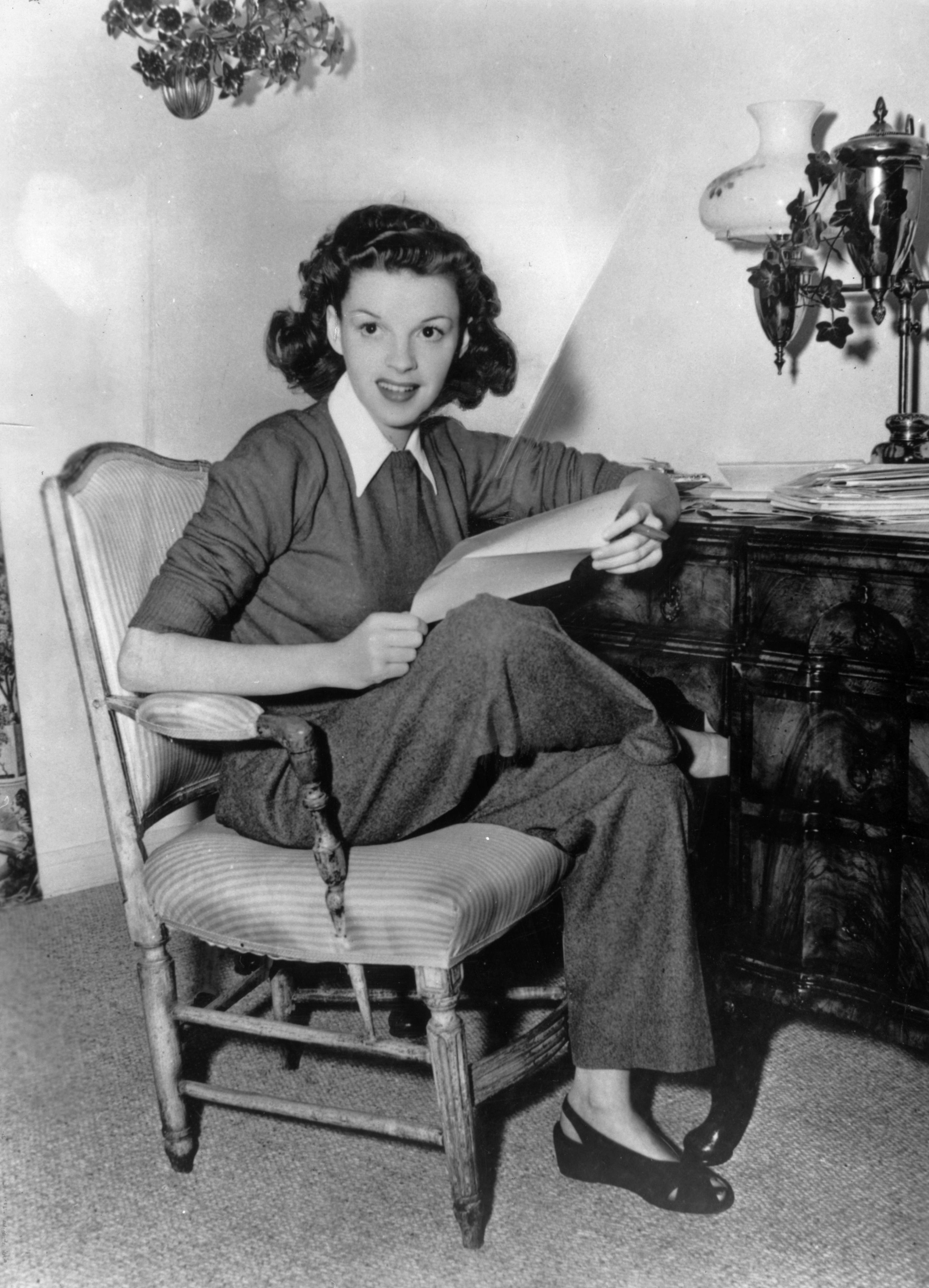 American film actress Judy Garland at home answering fan mail on January 01, 1944   Photo: Getty Images